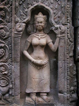 12th century: 12th Century beautiful sculpture of an Apsara (dancing woman) at the amazing Prea Khan temple, near Angkor Wat (Siem Reap, Cambodia).