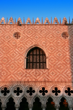 Venezia symbol: Palazzo Ducale (Doges Palace) near San Marco Basilica, at sunset (Venice, Italy)  photo