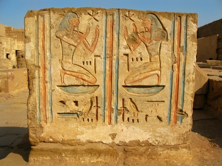 Luxor: Polychromed carvings at the temple of Medinet Habu, dedicated to Rameses III. West bank, Luxor, Egypt