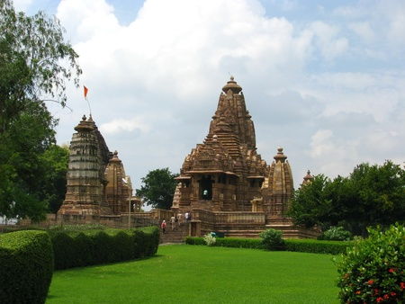 India: Temples of Khajuraho, one of the most popular tourist destinations in India, and famous for their erotic sculptures. Unesco World Heritage. Stock Photo - 11929628