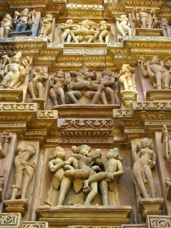 India: Temples of Khajuraho, one of the most popular tourist destinations in India, and famous for their erotic sculptures. Unesco World Heritage. Stock Photo - 11929669