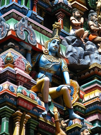 Varanasi (Benares), India: polychromed figures of hinduist gods on the roof of a temple. photo