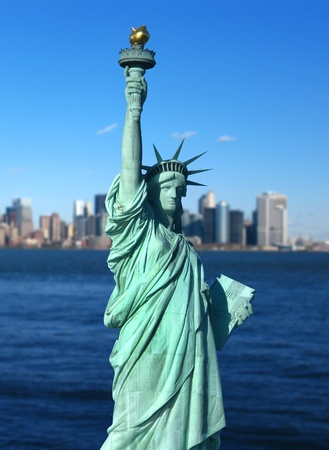 statue of liberty: New York  The Statue of Liberty, an American symbol, with Lower Manhattan skyline in the background  Tourism concept photo  Liberty Island, New York City, USA