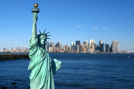 liberty statue: New York: The Statue of Liberty, an American symbol, with Lower Manhattan skyline in the background. Tourism concept photo. Liberty Island, New York City, USA