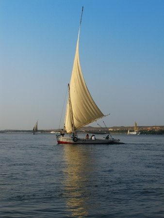Aswan, Egypt: traditional felucca boat sailing on the river Nile