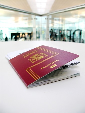 Passport and boarding pass, waiting for a flight in a modern airport photo