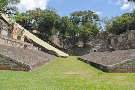 Copan, Honduras: ceremonial ball game court in Copan, one of the most important Mayan archaeological sites.  Stock Photo