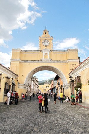 ANTIGUA, GUATEMALA - AUGUST 16, 2014: Arch of Santa Catalina, an icon of the city. Antigua was the former colonial capital of Guatemala, and was severily damaged in 1776 by an earthquake.