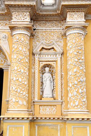 Antigua, Guatemala: Detail of La Merced Church facade, built in 1767, following guatemaltecan baroque style. The statue represents Santa Maria de Cervello (Barcelona, 1230-1290). Stock Photo