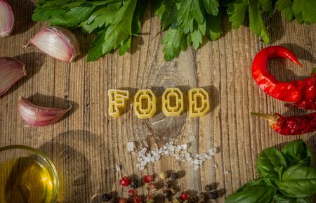 Uncooked pasta letters make up the word food. photo set. 스톡 콘텐츠