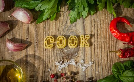 Uncooked pasta letters make up the word cook. photo set.