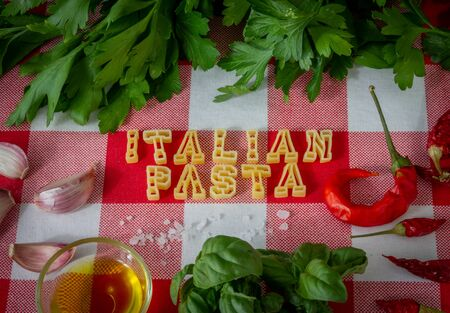 Uncooked pasta letters make up the word italian pasta. photo set.