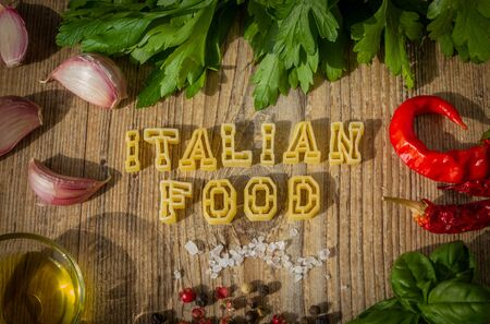 Uncooked pasta letters Italian food word make up. photo set.