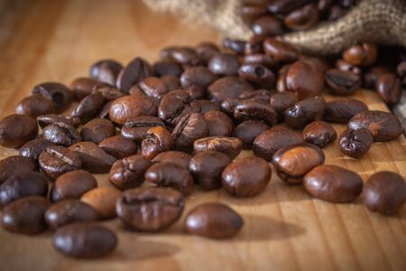 coffee beans and burlap sack on wooden background Stock fotó