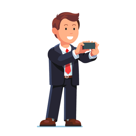 Business man taking photo with mobile phone