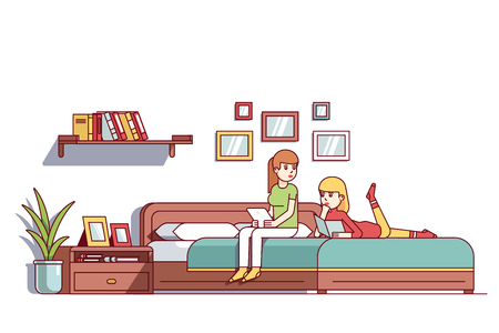 Two woman sitting on bedroom double bed talking