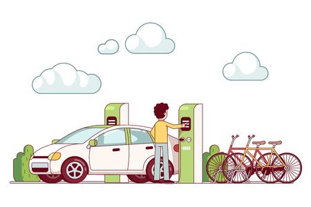 Man charging electric car at power station