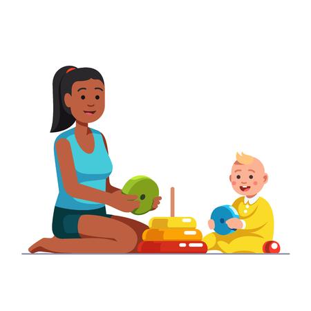 Vrouwelijke oppas spelen met babyjongen. Stockfoto - 96325802