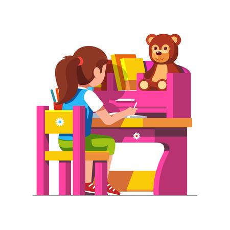 School girl studying sitting at pink child desk.
