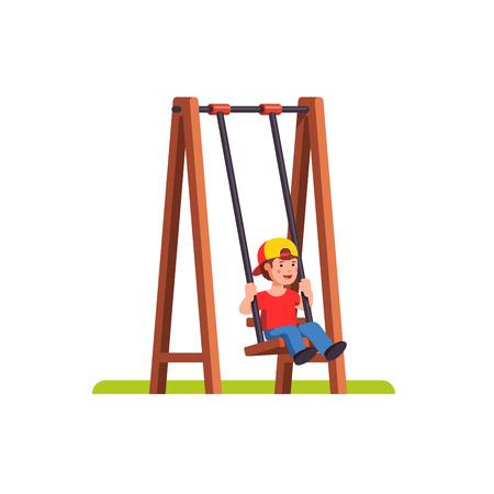 Little boy swinging on swing on public playground.