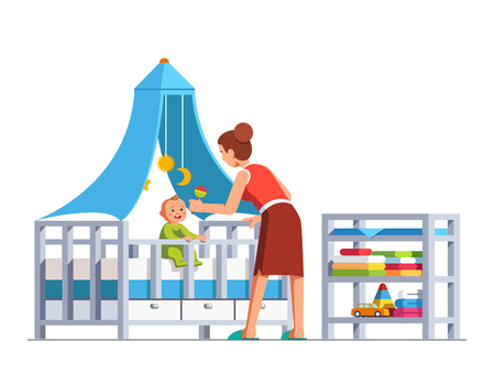 Mother playing rattle to little baby son toddler sitting in crib bed or cot.  Flat cartoon vector illustration.