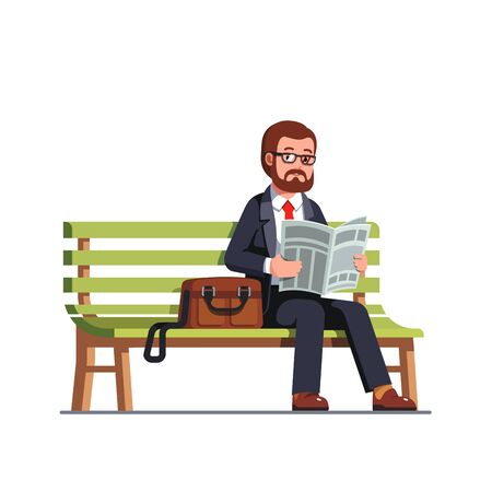 Business man reading newspaper sitting on a bench
