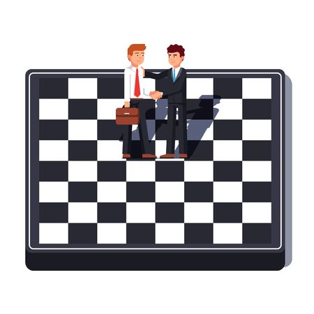 Business men shaking hands standing on chess board