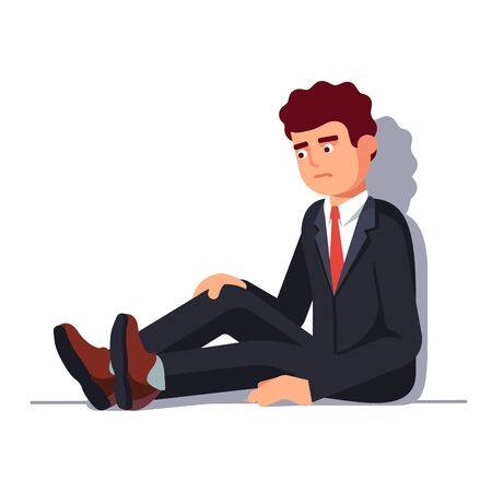 Depressed business man sitting leaning on wall
