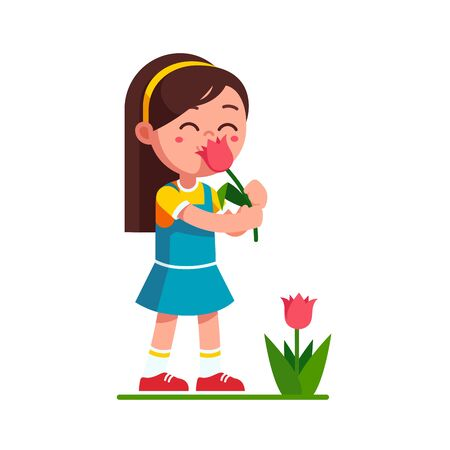 Girl kid holding tulip flower and smelling it