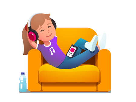 Girl in armchair enjoying music playing on phone