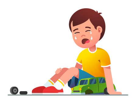 Sad boy kid sitting crying over broken toy car