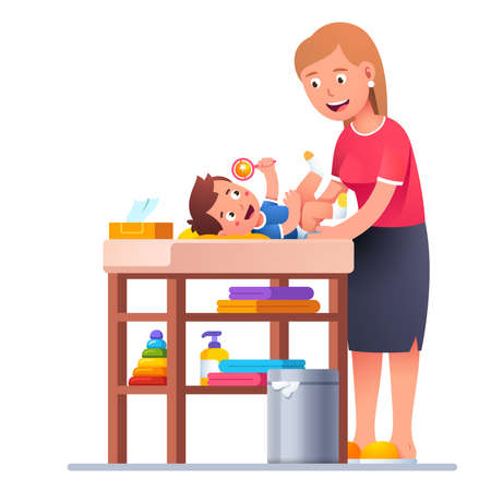 Mother changing diaper to happy toddler baby boy