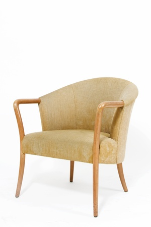 used: Contemporary light brown armchair on white background Stock Photo