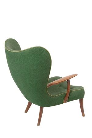 Green retro armchair on white background