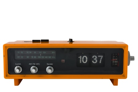 Vintage orange radio clock on white background
