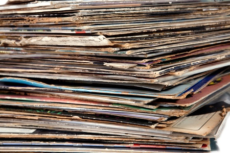 Pile of old vinyl records isolated on white background photo