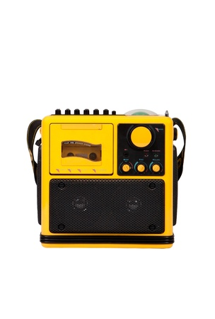 Old yellow radio on white background Stock Photo