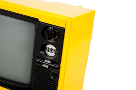 Old television yellow close up on white background photo
