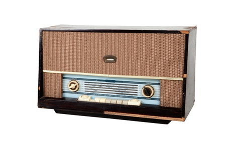 Analog wooden brown radio on white background photo