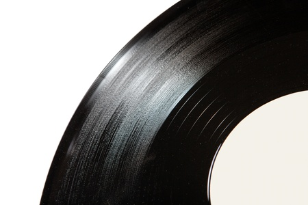 Old record disk close up on white background photo