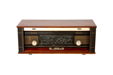 Old-fashioned wooden radio on white background