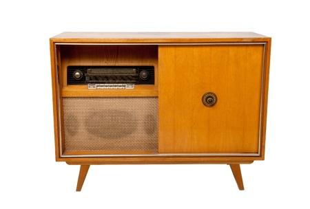 Old-fashioned wooden brown radio box on white background