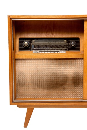 Old-fashioned wooden brown radio box on white background,close up view
