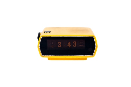 Old yellow digital clock on white background
