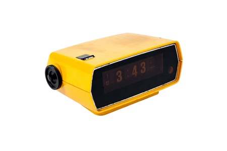 Old yellow digital clock on white background photo