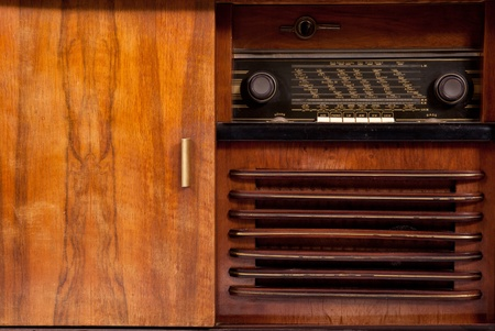 Old-fashioned wooden brown radio box on white background photo