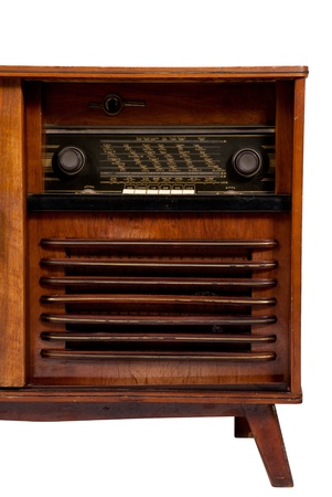Old-fashioned wooden brown radio box on white background, close up view photo