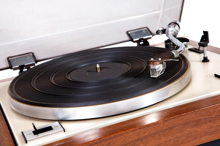 Old wooden vinyl player on white background