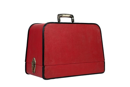 Old red vintage suitcase on white background
