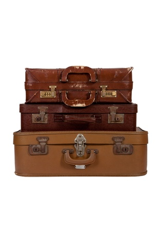 Pile of old brown suitcase on white background